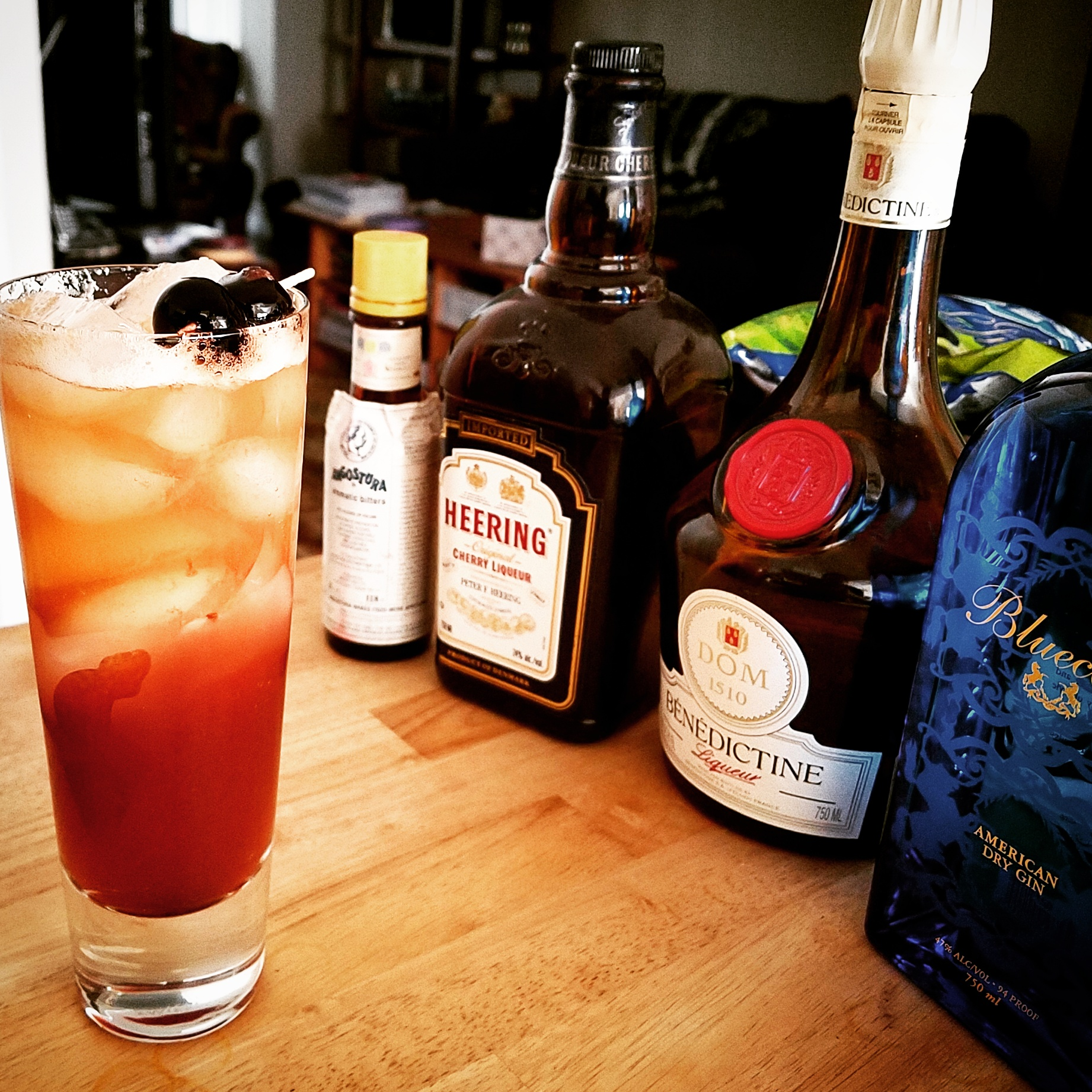 Sling made: Gin, lime, Benedictine, Cherry Heering and a few dashes of bitters.