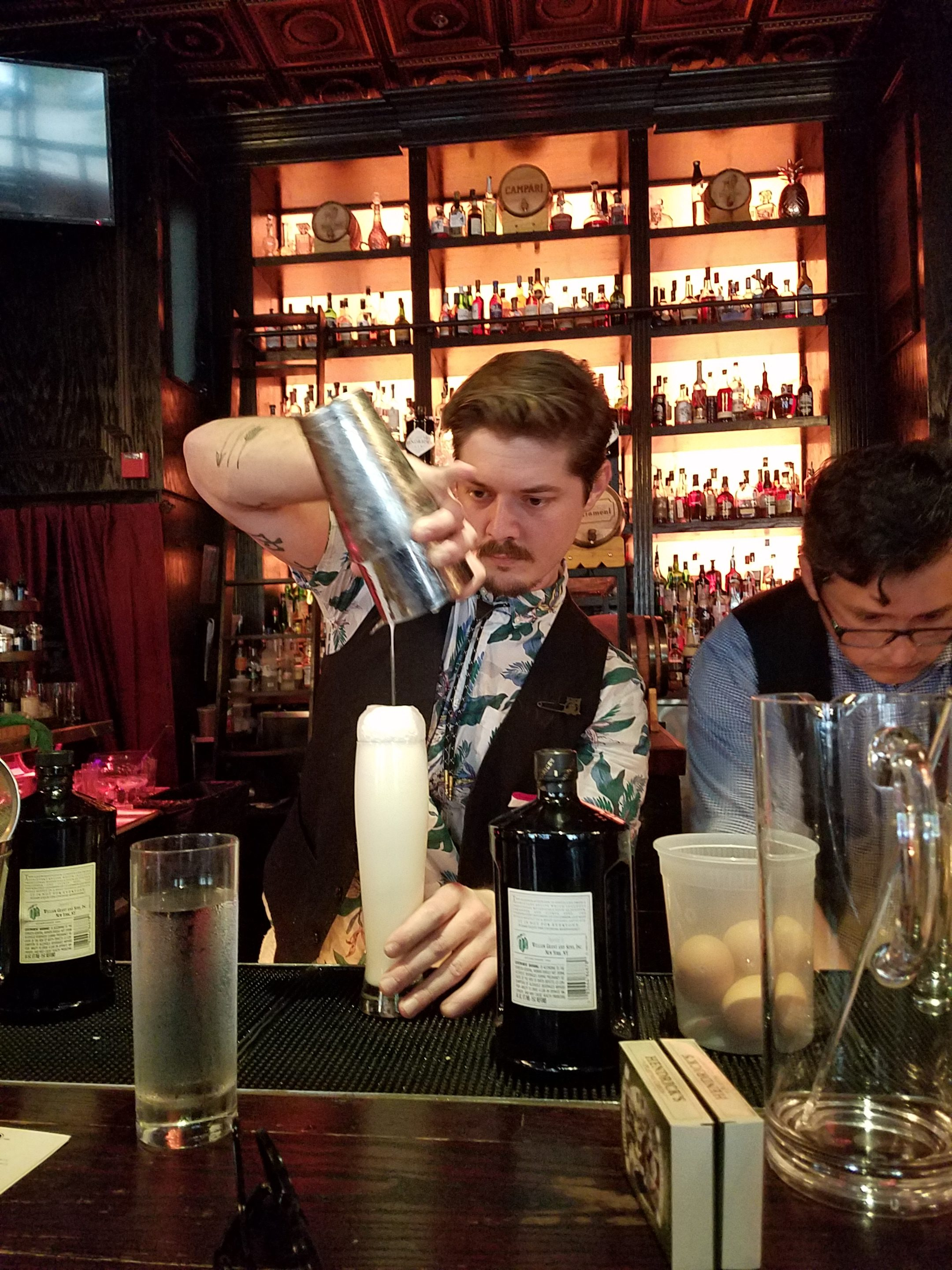 Bartender Jesse Powell dropping a Ramos Gin Fizz at Parliament.